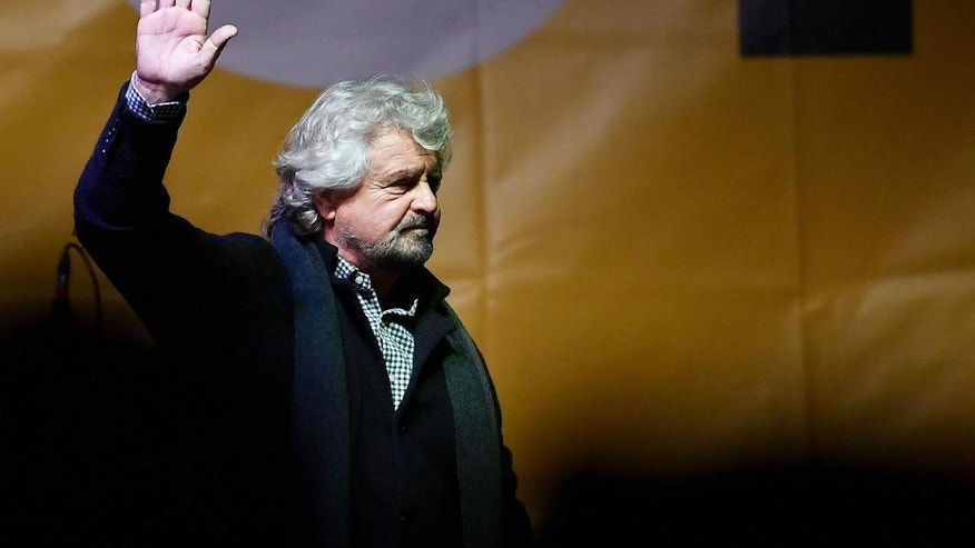 Leader of Five-Star Movement Beppe Grillo waves as he addresses a rally on the upcoming Italian constitutional referendum in Turin, Italy, Friday, Dec. 2, 2016. (Alessandro Di Marco/ANSA via AP)