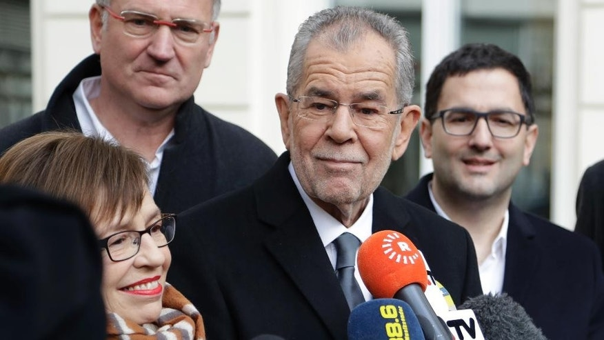 Alexander Van der Bellen, candidate of the Austrian Greens, briefs the media besides his wife Doris Schmidauer after leaving a polling station and casting their votes in Vienna, Austria, Sunday, Dec. 4, 2016. Austria holds presidential elections in a contest pitting a left-leaning contender against a right-winger supported by a populist anti-immigration party. (AP Photo/Matthias Schrader)