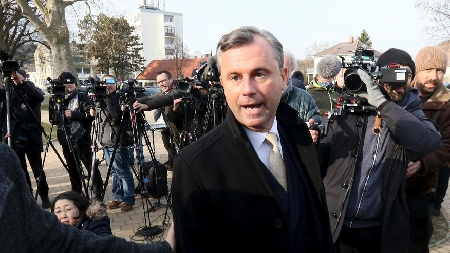 Norbert Hofer of Austria's Freedom Party, FPOE, speakes to press after casting his vote during the Austrian presidential elections, in Pinkafeld, Austria, Sunday, Dec. 4, 2016. (AP Photo/Ronald Zak)