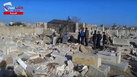 This frame grab from video provided on Oct. 17, 2016, by the Aleppo News Network, shows men standing in an graveyard during a burial ceremony in eastern Aleppo city, in Syria. The old Aleppo cemetery filled up a year ago, the new one filled up this week, and now the dead are left in the besieged enclave's streets, buried in backyards and overwhelming the morgues. Dignity in death has been lost as the rebel-held enclave of eastern Aleppo that held out for four years collapses. (Aleppo News Network via AP)