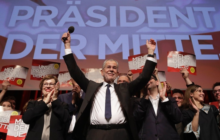Presidential candidate Alexander Van der Bellen, a former leading member of the Greens Party, celebrates on the podium at a party of his supporters in Austria's capital Vienna Sunday, Dec. 4, 2016, after the first official results from the Austrian presidential election showed left-leaning candidate Alexander Van der Bellen with what appears to be an unbeatable lead over right-winger Norbert Hofer. (AP Photo/Matthias Schrader)
