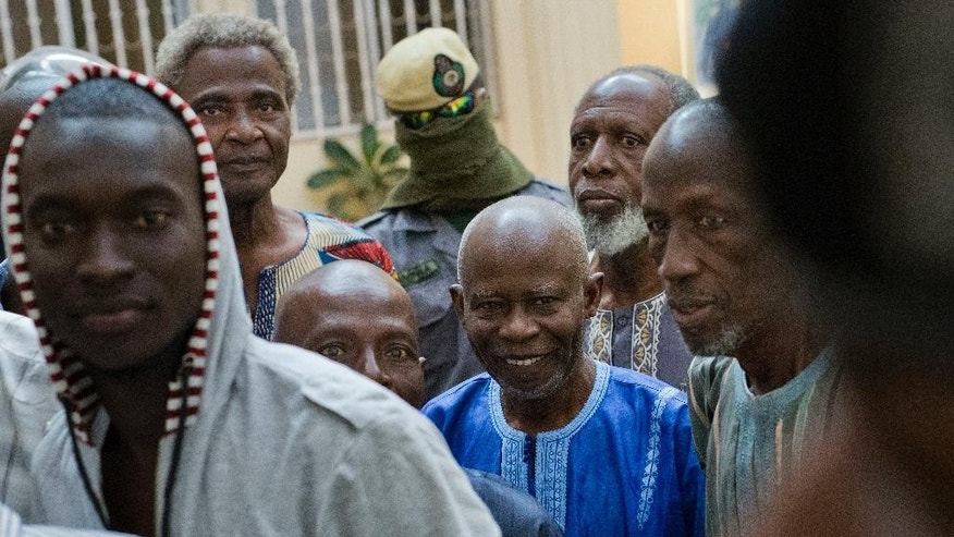 Ousainou Darboe, the head of the United Democratic Party, centre, arrives with 18 others for their hearing at Gambia's supreme court in Banjul, Monday, Dec. 5, 2016. They had been arrested in April 2016 after they took part in a peaceful demonstration and sentenced to three years in prison. The appeals court ordered their release on bail, just days after strongman ruler Yahya Jammeh agreed to step aside after losing the presidential election to Adama Barrow. (AP Photo/Jerome Delay)