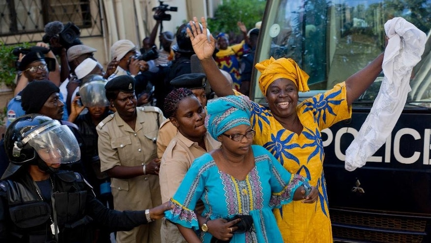 Political prisoners, including Ousainou Darboe, the head of the United Democratic Party arrive for their hearing at Gambia's supreme court in Banjul,, Monday, Dec. 5, 2016. They had been arrested in April 2016 after they took part in a peaceful demonstration and sentenced to three years in prison. The appeals court ordered their release on bail, just days after strongman ruler Yahya Jammeh agreed to step aside after losing the presidential election to Adama Barrow. (AP Photo/Jerome Delay)