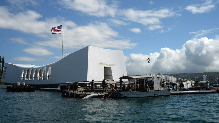 FILE- In this June 3, 2015 file photo released by the U.S. Navy, sailors work to repair the floating dock next to the USS Arizona Memorial in Pearl Harbor, Hawaii, after the USNS Mercy hospital ship struck the memorial's dock in May as it was leaving Pearl Harbor.