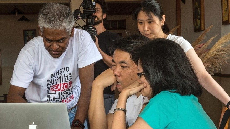 V.P.R. Nathan, left, whose wife, Anne Daisy, was on board the missing Malaysia plane, talks with other relatives of passengers during their meeting at a hotel in Antananarivo, Madagascar, Sunday, Dec.4, 2016. The group of 8 relatives of some of the 239 people who were on a Malaysia Airlines plane that vanished in 2014 have arrived in Madagascar to ask for help in the search for debris from the missing aircraft that may have drifted across the Indian Ocean. (AP Photo/Alexander Joe)