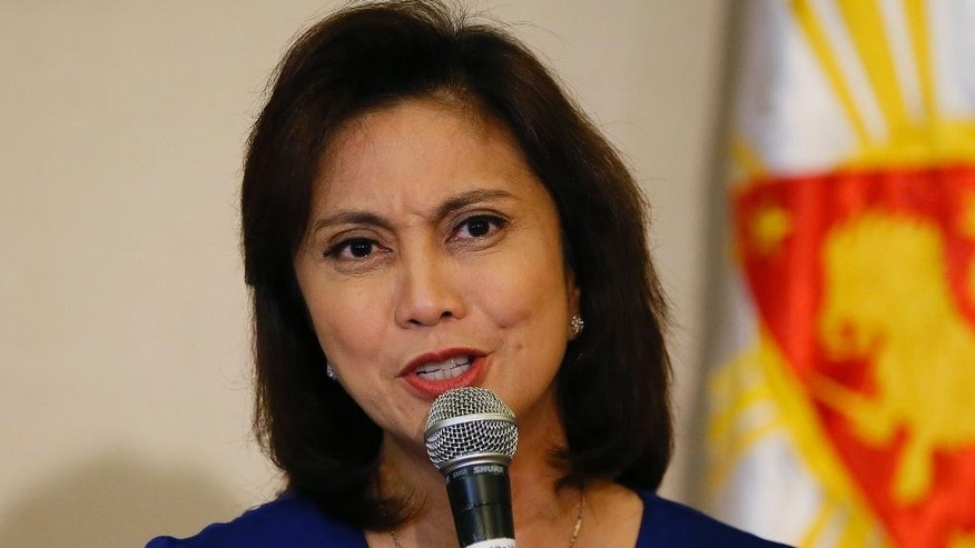Philippine Vice President Leni Robredo answers questions from the media during a news conference following her resignation from her cabinet post under President Rodrigo Duterte Monday, Dec. 5, 2016 in suburban Quezon city, south of Manila, Philippines. Robredo resigned her Cabinet post Monday after citing irreconcilable differences with Duterte, who had banned her from attending Cabinet meetings, in a new political dilemma for the leader. (AP Photo/Bullit Marquez)