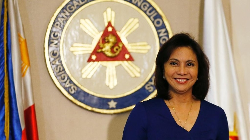 Philippine Vice President Leni Robredo smiles prior to a news conference following her resignation from her cabinet post under President Rodrigo Duterte Monday, Dec. 5, 2016 in suburban Quezon city, south of Manila, Philippines. Robredo resigned her Cabinet post Monday after citing irreconcilable differences with Duterte, who had banned her from attending Cabinet meetings, in a new political dilemma for the leader. (AP Photo/Bullit Marquez)