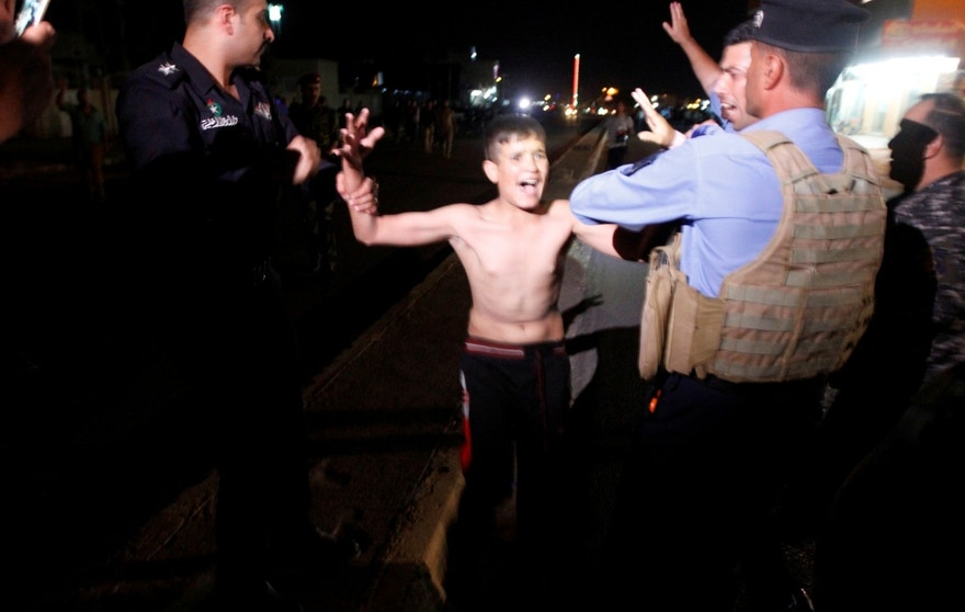 Iraqi security forces detain a boy after removing a suicide vest from him in Kirkuk, Iraq, August 21, 2016. REUTERS/Ako Rasheed - RTX2MG72