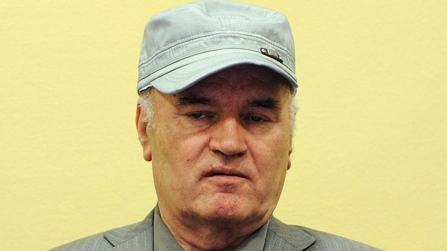 FILE - In this Friday, June 3, 2011, file photo former Bosnian Serb Gen. Ratko Mladic sits in the court room during his initial appearance at the U.N.'s Yugoslav war crimes tribunal in The Hague, Netherlands. UN prosecutors deliver their closing statement in the marathon genocide trial of former Bosnian Serb military chief Gen. Ratko Mladic, who is accused of commanding forces responsible for the worst atrocities of the Bosnian war. (AP Photo/ Martin Meissner, Pool, File)