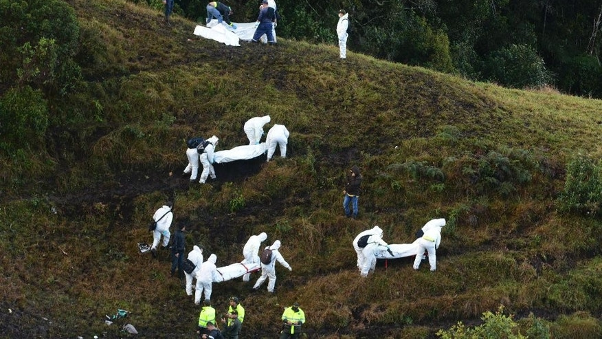 2016 AP YEAR END PHOTOS - Rescue workers carry the bodies of victims of an airplane crash in a mountainous area near La Union, Colombia, on Nov. 29, 2016. The plane was carrying the Brazilian first division soccer club Chapecoense team, which was on its way for a Copa Sudamericana final match against Colombia's Atletico Nacional. (AP Photo/Luis Benavides, File)