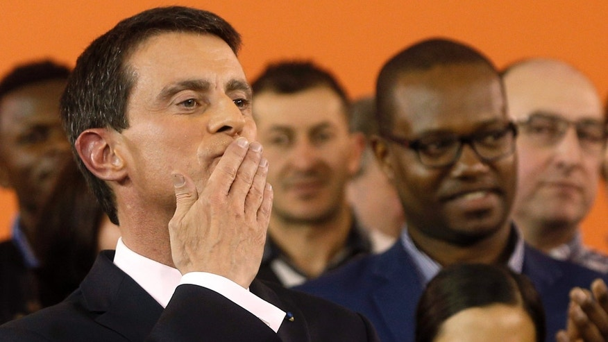 Dec. 5, 2016: French Prime Minister Manuel Valls blows a kiss to the audience after announcing his candidacy for the Socialist primary next month, in Evry, outside Paris.