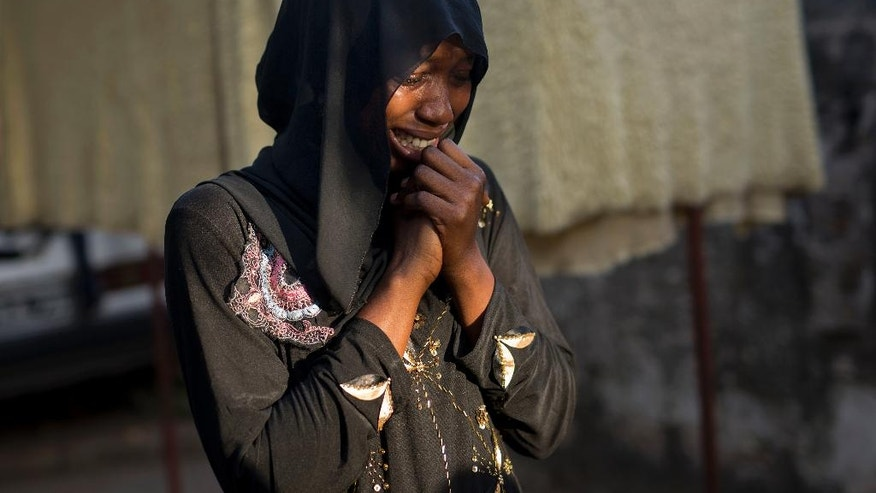 In this photograph taken Saturday, Dec. 3, 2016, Fatoumata Sawaneh, breaks down as she recalls her father Imam Ousman Sawaneh, in her family's home in Kanifing, Gambia. Sawaneh tries desperately to hold back tears while talking about her father, Imam Ousman Sawaneh of Kanifing South, who was among three imams arrested in October 2015. She has not heard from him since, and like so many others in Gambia, fears for their loves ones' life.Though the sudden disappearances are often unexplained, it is a familiar tale for so many under President Yahya Jammeh's 22-year rule, which has created a climate of fear and mistrust. AP Photo/Jerome Delay)