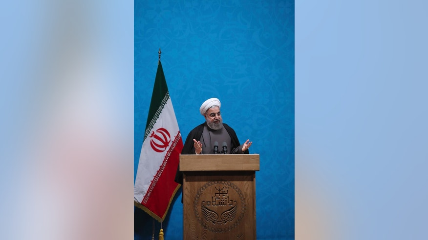 "In this photo released by official website of the office of the Iranian Presidency, President Hassan Rouhani speeches in a ceremony marking Student Day at Tehran University in Tehran, Iran, Tuesday, Dec. 6, 2016. Iran's president said Tuesday his country will not allow incoming U.S. President Donald Trump to ""tear up"" Tehran's landmark nuclear deal with world powers. Rouhani says that while the president-elect ""may desire to weaken the nuclear deal,"" such desires ""cannot affect our will."" His remarks underscore Iranian leaders' attempts to calm concerns over the future of the deal in the wake of Trump's election. (Iranian Presidency Office via AP)"
