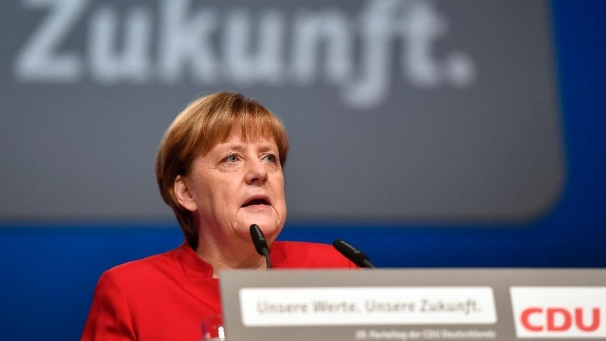 German Chancellor Angela Merkel speaks during a general party conference of the Christian Democratic Union (CDU) in Essen, Germany, Tuesday, Dec. 6, 2016. Merkel wants to secure the backing of her conservative party to head up the party's campaign for next September's election. Word in the background reads 'Future'. (AP Photo/Martin Meissner)
