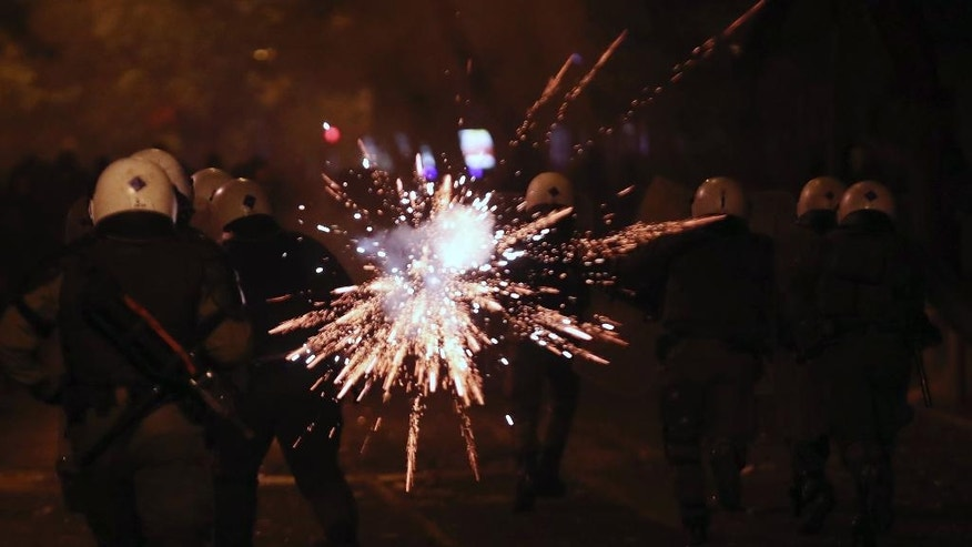 Protesters throw fireworks at riot police during clashes in Athens, on Tuesday, Dec. 6, 2016. Riots have broken out in central Athens, with dozens of youths throwing petrol bombs at police after a peaceful march to commemorate the police killing of a teenager eight years ago. (AP Photo/Yorgos Karahalis)