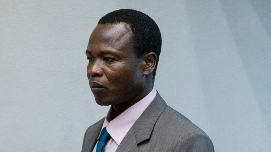 Dominic Ongwen, a senior commander in the Lord's Resistance Army, whose fugitive leader Kony is one of the world's most-wanted war crimes suspects, enters the court room of the International Court in The Hague, Netherlands, Tuesday, Dec. 6, 2016. (AP Photo/Peter Dejong, Pool)