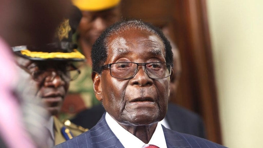 Zimbabwean President Robert Mugabe is seen upon arrival for his annual State of the Nation address at Parliament in Harare, Tuesday, Dec. 6, 2016. Zimbabwe President Robert Mugabe has appealed for calm, as his government battles to contain a debilitating economic crisis. (AP Photo/Tsvangirayi Mukwazhi)
