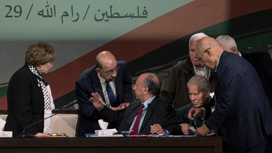 "This photo taken Tuesday, Nov. 29, 2016, shows Fatah members talk ahead of the opening session of the Fatah party seventh conference in the West Bank city of Ramallah. Arabic in the background reads ""Palestine, Ramallah."" The recent conference of the ruling Fatah party sent a disheartening message to young Palestinians: Most of those elected to top positions were in their 60s and 70s, signaling that politics under octogenarian President Mahmoud Abbas is an old man's game and that it is unlikely that fresh ideas on winning statehood will emerge from this group of veteran loyalists. (AP Photo/Nasser Nasser)"