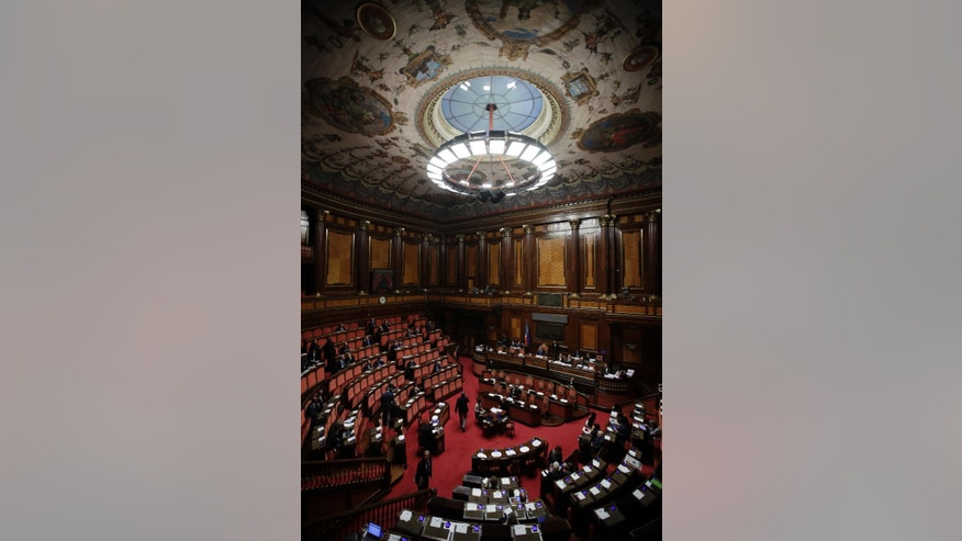 A view of the Italian Senate, in Rome, Wednesday, Dec. 7, 2016 before the start of a confidence vote on the 2017 budget law. Italian President Sergio Mattarella told Italian premier Matteo Renzi, who decided to resign after a humiliating defeat in a referendum on government-championed reforms, to stay in office a bit longer until the critical budget law is passed. (AP Photo/Alessandra Tarantino)
