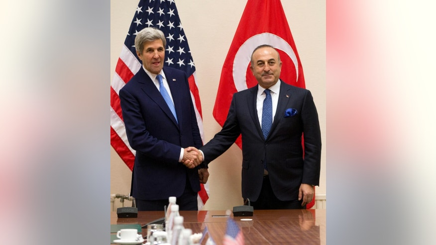 U.S. Secretary of State John Kerry, left, and Turkish Foreign Minister Mevlut Cavusoglu shake hands prior to a bilateral meeting on the sidelines of a NATO foreign ministers at NATO headquarters in Brussels on Tuesday, Dec. 6, 2016. NATO foreign ministers on Tuesday will discuss closer EU-NATO cooperation. (AP Photo/Virginia Mayo, Pool)