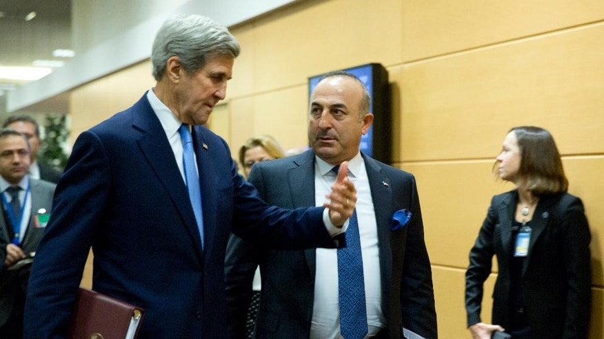 U.S. Secretary of State John Kerry, left, speaks with Turkish Foreign Minister Mevlut Cavusoglu, center, prior to a bilateral meeting on the sidelines of a NATO foreign ministers at NATO headquarters in Brussels on Tuesday, Dec. 6, 2016. NATO foreign ministers on Tuesday will discuss closer EU-NATO cooperation. (AP Photo/Virginia Mayo, Pool)