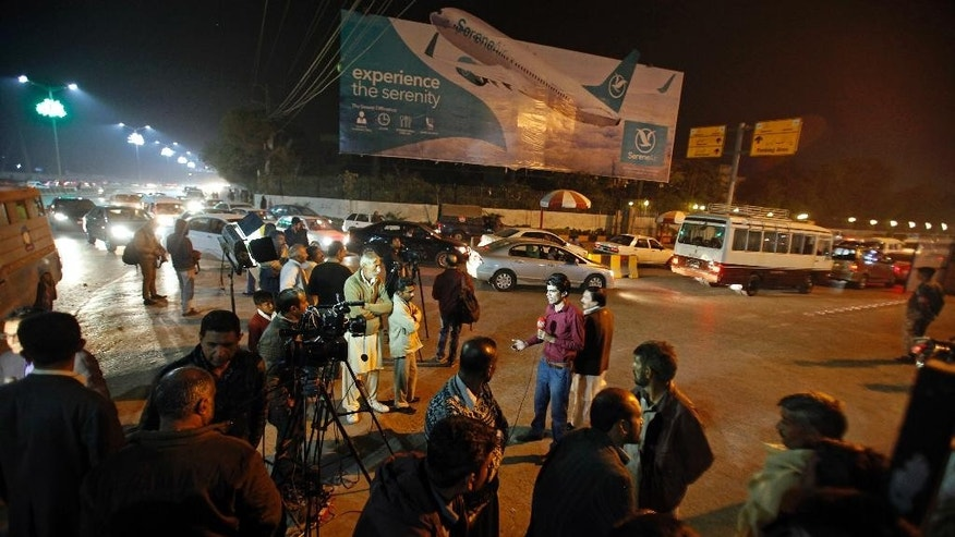 Pakistani media and residents gather at Benazir Bhutto International Airport following a report that a passenger plane from Chitral, in the country's north, had crashed near a village near the town of Havelian, in Islamabad, Pakistan, Wednesday, Dec. 7, 2016. Pakistan International Airlines said that the ATR-42 aircraft carrying around 40 passengers and crew lost touch with the control tower and that all resources are being mobilized. (AP Photo/Anjum Naveed)