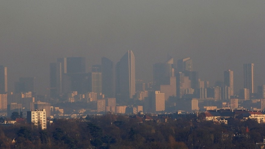 Dec. 5, 2016: A small-particle haze hangs above the La Defense business district skyline that is seen in the distance in Courbevoie, near Paris, France.