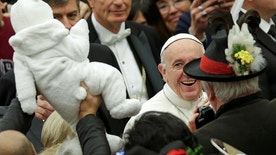 Pope Francis smiles to a baby as he arrives to lead the general audience in Paul VI Hall at the Vatican December 7, 2016. REUTERS/Max Rossi - RTSV0V5