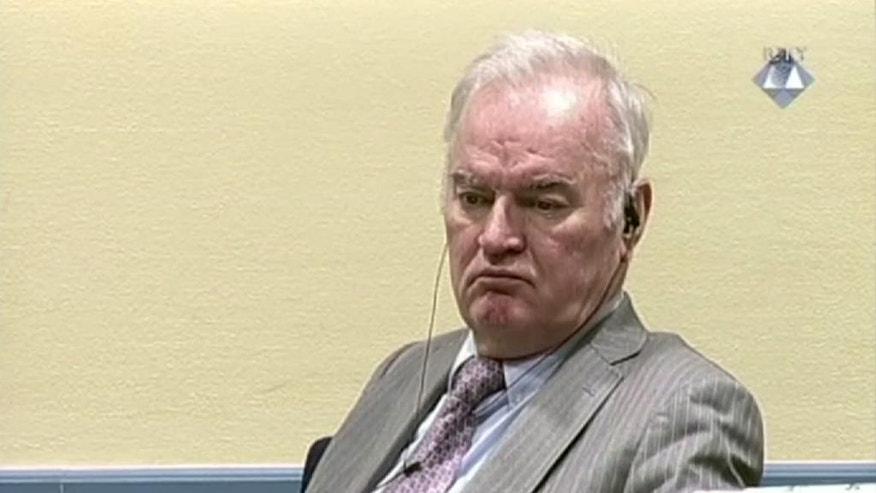 Former Bosnian Serb military chief General Ratko Mladic looks across the court room at the  International Criminal Tribunal for the Former Yugoslavia in the Hague Netherlands in this image taken from video Wednesday Dec. 7, 2016. United Nations prosecutors on Wednesday demanded a life sentence for Gen. Ratko Mladic, telling judges that they should convict and imprison the former Bosnian Serb military chief for orchestrating atrocities throughout Bosnia's 1992-95 war.   (ICTY Video via AP)