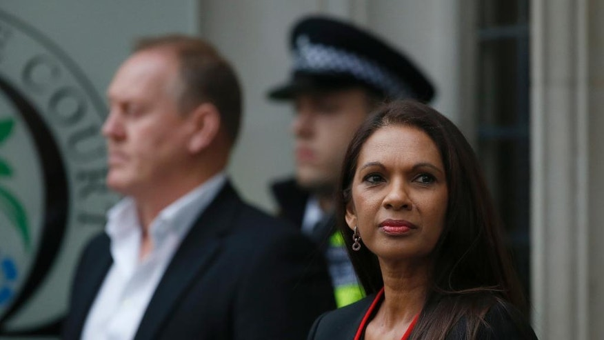 Gina Miller,  who won a High Court ruling forcing the British government to seek Parliamentary approval before leaving the European Union, arrives for the fourth day of legal argument at The Supreme Court in London, Thursday, Dec. 8, 2016. The British Government led by Prime Minister Theresa May will ask Supreme Court justices to overturn a ruling that Parliament must hold a vote before Britain's exit negotiations can begin  a case that has raised a constitutional quandary and inflamed the country's heated debate about Brexit. (AP Photo/Alastair Grant)