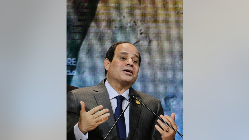 FILE -- In this March 15, 2015 file photo, Egyptian President Abdel-Fattah el-Sissi speaks during the final day of a major economic conference, in Sharm el-Sheikh, Egypt. On Thursday, Dec. 8, 2016, Egypt's president defended the tough economic measures his government has undertaken, at a gathering of clerics ahead of the Prophet's Birthday, a major Islamic holiday, saying there was no alternative in the face of deteriorating economy. The remarks were the first by el-Sissi since the government's unprecedented floatation of the Egyptian pound, meant to ensure that Egypt qualifies for a 12 billion dollar loan from the IMF. (AP Photo/Thomas Hartwell, File)