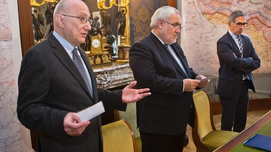 Radu Ioanid, director of the International Archival Programs Division at the United States Holocaust Memorial Museum, left, speaks while French Secretary of State for Veterans and Remembrance Jean-Marc Todeschini, center, and Jacques Fredj, Executive Director of France's Shoah Memorial stay next to him during a signing ceremony in Paris, Thursday, Dec. 8, 2016. France's Defense Ministry signs a deal to hand over digitized versions of its archives around World War II persecution of Jews to Holocaust museums in Washington and Paris so that the public can access them. (AP Photo/Michel Euler)