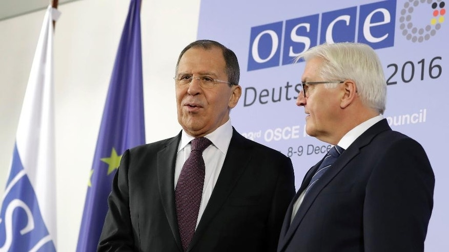 German Foreign Minister Frank-Walter Steinmeier, right, welcomes Russian Foreign Minister Sergey Lavrov, left, for a meeting of the Organization for Security and Co-operation in Europe (OSCE) council of foreign ministers in Hamburg, Germany, Thursday, Dec. 8, 2016. (AP Photo/Michael Sohn)