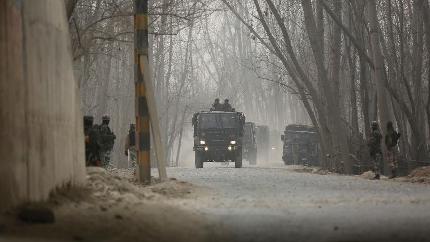 Indian soldiers stand guard near the site of a gun battle at Arwani, 55 kilometers (34 miles) south of Srinagar, Indian-controlled Kashmir, Thursday, Dec. 8, 2016. Dozens of civilians in Indian-controlled Kashmir were injured on Thursday as anti-India clashes erupted in the disputed region following a gun battle between rebels and government forces, officials and witnesses said. (AP Photo/Mukhtar Khan)