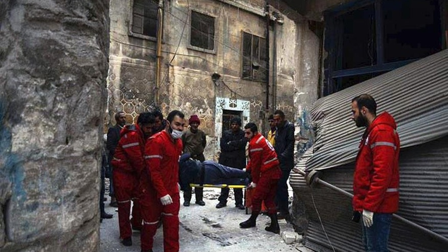 This Wednesday, Dec. 7, 2016 photo, released by the International Committee for the Red Cross, shows members of the Syrian Arab Red Crescent carrying a patient on stretcher out of a medical facility in the Old City of Aleppo, Syria. The ICRC said it evacuated 148 disabled or civilians in need of urgent care from the facility, now under Syrian government control. ICRC said in a statement Thursday the evacuation was possible after fighting calmed down in the area. (Syrian Arab Red Crescent/Noor Hazouri via AP)