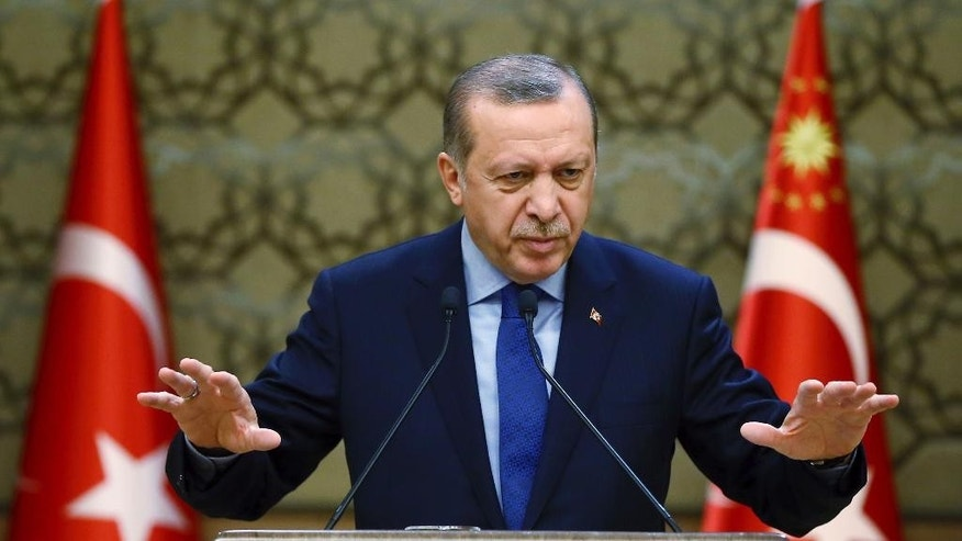 Turkey's President Recep Tayyip Erdogan addresses local administrators in Ankara, Turkey, Wednesday, Dec. 7, 2016. (Kayhan Ozer, Presidential Press Service, Pool photo via AP)