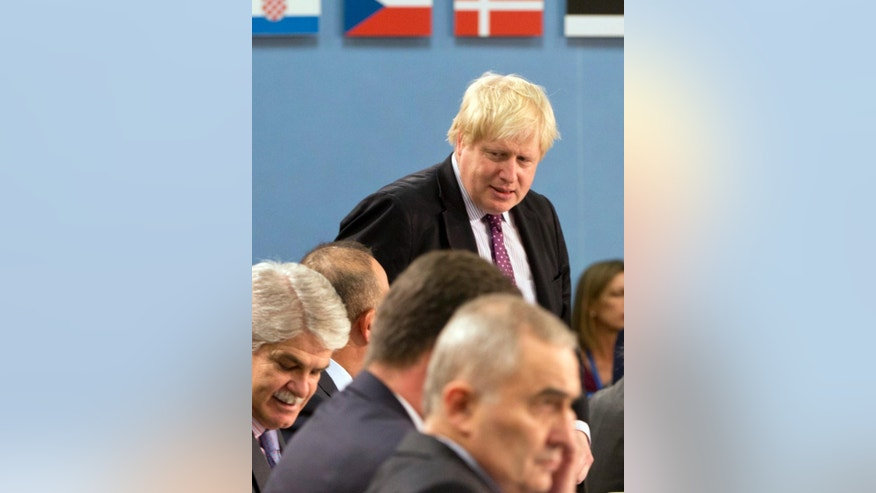 British Foreign Secretary Boris Johnson, center, takes his seat during a round table meeting of the NATO-Ukraine Commission at foreign ministers level at NATO headquarters in Brussels on Wednesday, Dec. 7, 2016. (AP Photo/Virginia Mayo)