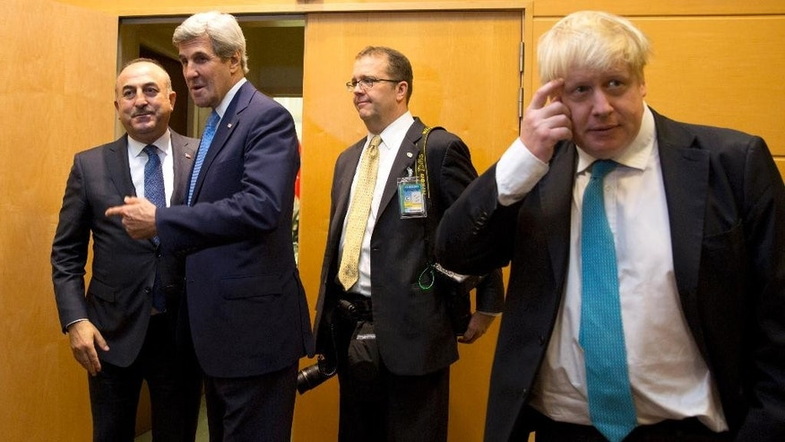 U.S. Secretary of State John Kerry, second left, speaks with Turkish Foreign Minister Mevlut Cavusoglu, left, while British Foreign Secretary Boris Johnson, right, waits during a meeting on the sidelines of a NATO foreign ministers at NATO headquarters in Brussels on Tuesday, Dec. 6, 2016. NATO foreign ministers on Tuesday will discuss closer EU-NATO cooperation. (AP Photo/Virginia Mayo, Pool)