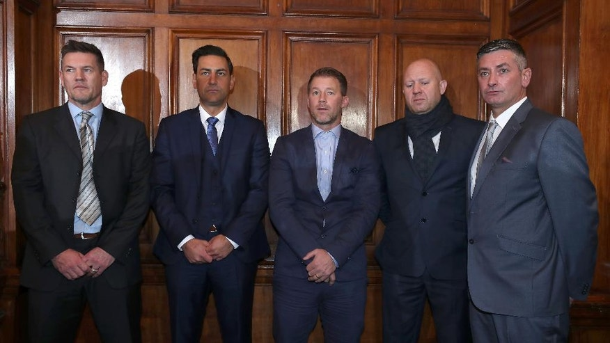 From left, former soccer players Mark Williams, Andy Woodward, Steve Walters, Jason Dunford and Matt Monaghan pose for the media at the launch of the Offside Trust at the Midland Hotel in Manchester, England, Monday, Dec. 5, 2016. In a growing scandal being investigated by 18 police forces across Britain, about 350 people have reported incidents of child sexual abuse at soccer clubs. The Offside Trust has been formed by Andy Woodward, Steve Walters and Chris Unsworth as an independent trust to support players and their families who have suffered from abuse. (Peter Byrne/PA via AP)