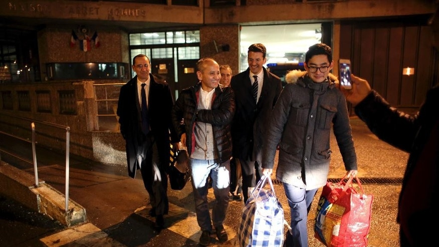 "Mukhtar Ablyazov, second from left, leaves the Fleury Merogis prison, escorted by his son Madiyar, right, and his lawyers, in Fleury Merogis, south of Paris, Friday, Dec. 9, 2016.   A top court in France refused Friday to hand a Kazakh banker-turned-dissident charged with embezzling billions over to Russia, saying it considered the extradition request from Moscow to be ""politically motivated."" (AP Photo/Thibault Camus)"
