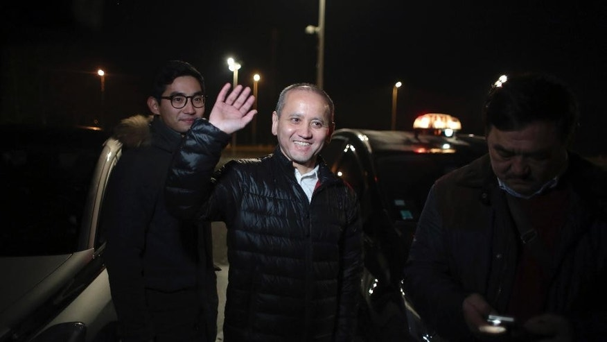 "Mukhtar Ablyazov, centre, waves as he leaves the Fleury Merogis prison, in Fleury Merogis, south of Paris, Friday, Dec. 9, 2016. A top court in France refused Friday to hand the Kazakh banker-turned-dissident charged with embezzling billions over to Russia, saying it considered the extradition request from Moscow to be ""politically motivated."" (AP Photo/Thibault Camus)"