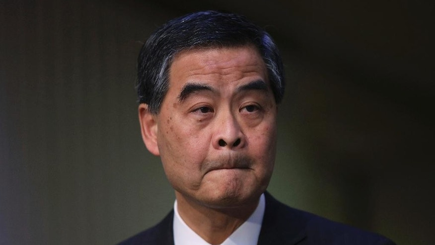 Hong Kong Chief Executive Leung Chun-ying speaks during a briefing in Hong Kong, Friday, Dec. 9, 2016. On Friday Leung said he wouldn't run again for the job after his current term ends next year, citing unspecified family reasons. (AP Photo/Man Choi)