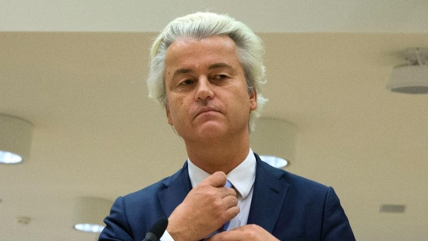 FILE - In this Wednesday, Nov. 23, 2016 file photo populist anti-Islam lawmaker Geert Wilders prepares to address judges at the high-security court near Schiphol Airport, Amsterdam. Judges are set to deliver their verdicts in the politically charged hate speech trial of Dutch anti-Islam lawmaker Geert Wilders. (AP Photo/Peter Dejong)