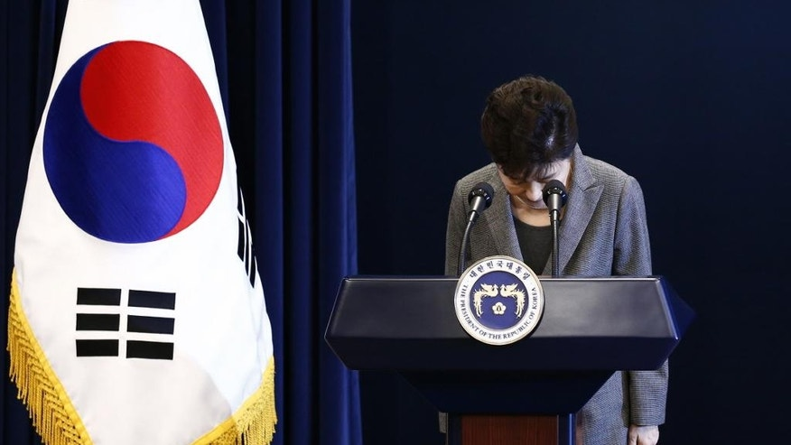 FILE - In this Nov. 29, 2016, file photo, South Korean President Park Geun-hye bows during her address to the nation while saying she'll resign if parliament comes up with a plan for the safe transfer of power, at the presidential Blue House in Seoul. South Korea. lawmakers on Friday impeached Park, a stunning and swift fall for the country's first female leader amid protests that drew millions into the streets in united fury. (Pool Photo via AP, File)