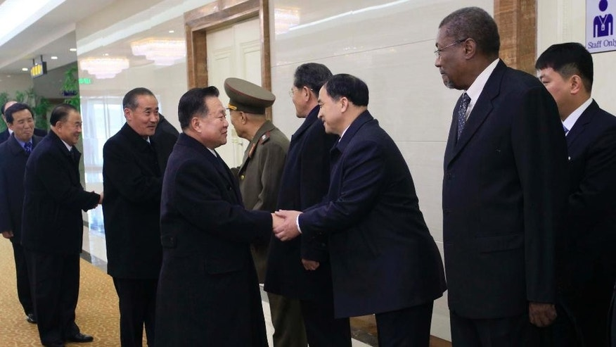 "Choe Ryong Hae, center left, a vice chairman of North Korea's Workers' Party, shakes hands with Deputy Foreign Minister Ri Kil Song, center right, as a delegation arrives at the Pyongyang Airport in Pyongyang, North Korea Friday, Dec. 9, 2016. The delegation of North Korean officials headed by one of Kim Jong Un's chief lieutenants returned to Pyongyang on Friday after visiting Cuba to pay respects to Fidel Castro, whom North Korea has called a ""great comrade."" (AP Photo/Jon Chol Jin)"