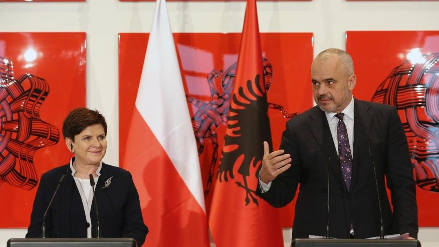 Albanian Prime Minister Edi Rama, right, speaks during a press conference with his Polish counterpart Beata Szydlo in Tirana, Friday, Dec. 9, 2016. Szydlo is in Albania for top-level talks on European security and integration and on bilateral cooperation in the economy. (AP Photo/Hektor Pustina)