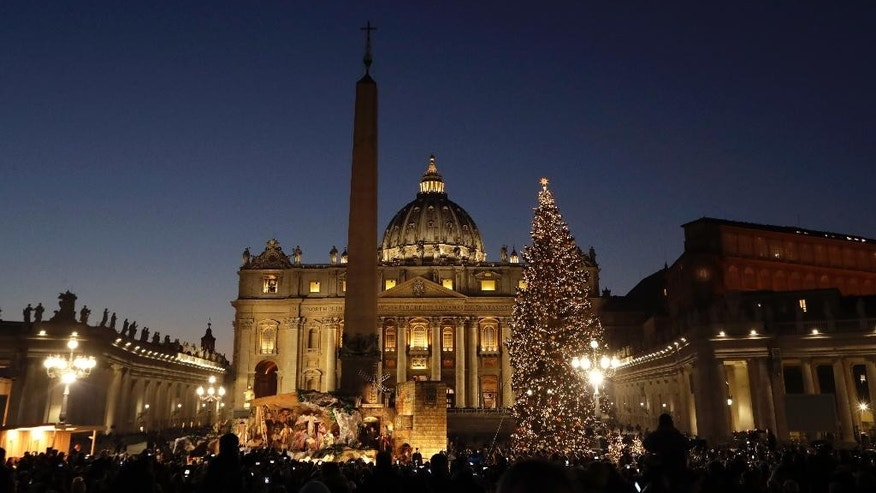The Christmas Tree and nativity scene are lit up in St. Peter's Square, at the Vatican during a ceremony, Friday, Dec. 9, 2016. (AP Photo/Andrew Medichini)