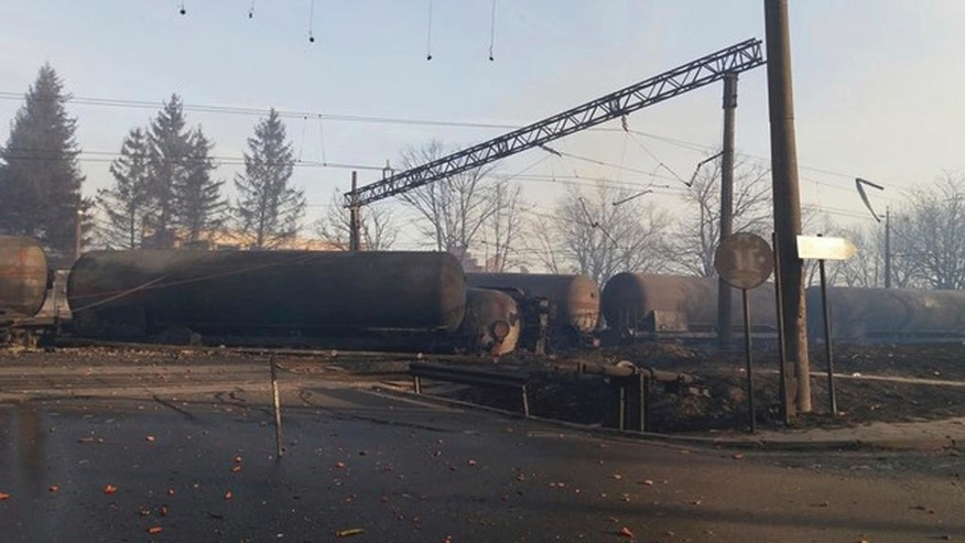 In this photo released by Bulgarian Interior Ministry, burned containers are seen derailed after an explosion upon derailment in the village of Hitrino in Bulgaria Saturday, Dec 10, 2016. Firefighters in Bulgaria said on Saturday that several people were killed when a train derailed and containers of gas exploded. (Bulgarian Interior Ministry via AP)