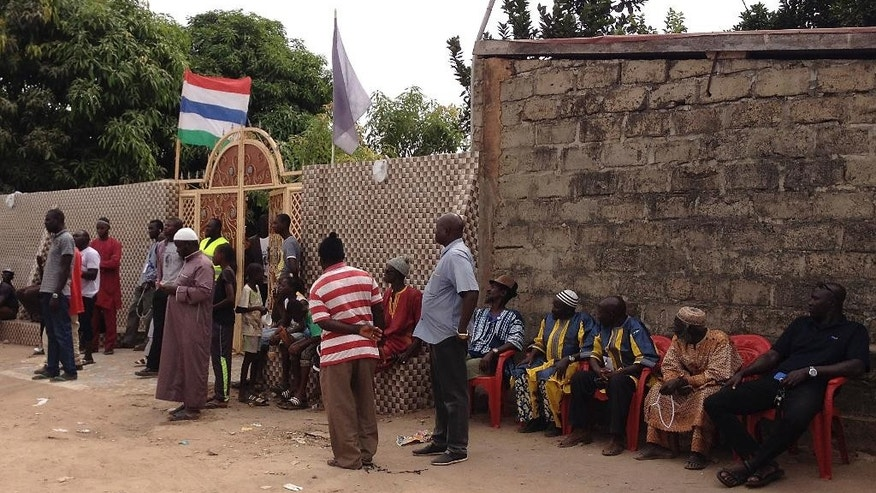 Supporters gather outside Gambia President-elect Adama Barrow's home before he spoke to members of the media in Banjul, Gambia, Saturday, Dec. 10, 2016. Gambia's president-elect said Saturday that the outgoing leader who now rejects his defeat has no constitutional authority to call for another election, and he called on President Yahya Jammeh to help with a smooth transition in the interest of the tiny West African country. (AP Photo/Dawda Bayo)