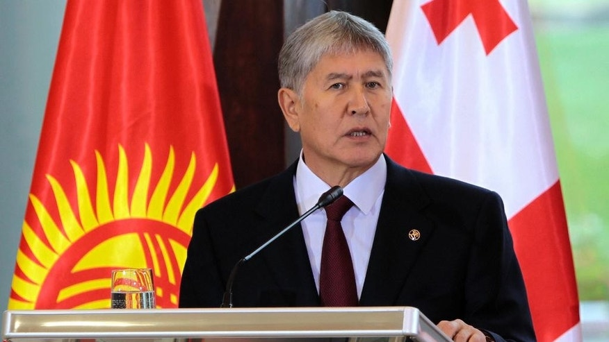 FILE - In this Oct. 13, 2016 file photo, Kyrgyz President Almazbek Atambayev speaks during a joint news conference with Georgian President Giorgi Margvelashvili after their talks in Tbilisi, Georgia during Atambayev's two-day official visit to Georgia. Voters in Kyrgyzstan are casting ballots on Sunday, Dec. 11, in a constitutional referendum, initiated by Atambayev, that includes amendments that boost the power of prime minister - something opposition groups have criticized in the ex-Soviet Central Asian nation. (AP Photo/Shakh Aivazov, File)